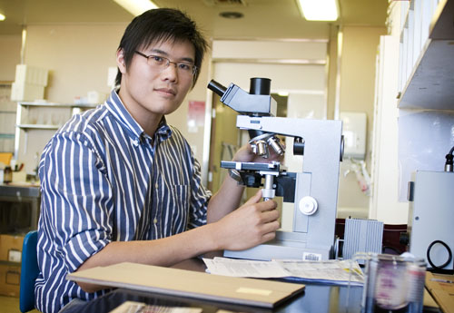 Researcher with microscope