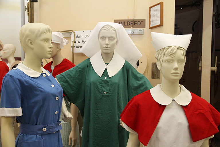 Three female mannequins from the Fremantle Hospital museum wearing different styles of nursing uniforms.