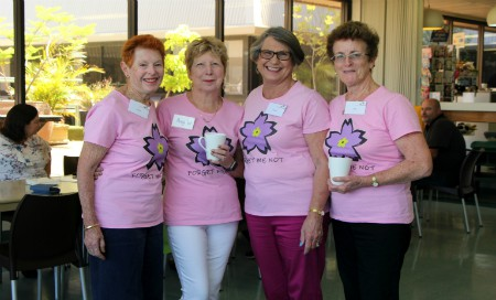 Four women wearing pink shirts standing in Fremantle Hospital cafe